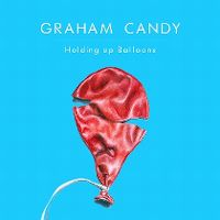 Holding up balloons - graham candy